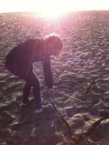 Ever the designer, Livvie redesigns the beach.